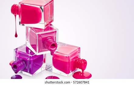 Bottles with spilled nail polish with place for text