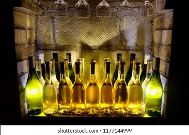 Bottles of Tokaji in Hungarian traditional cellars. Sweet white wine degustation.