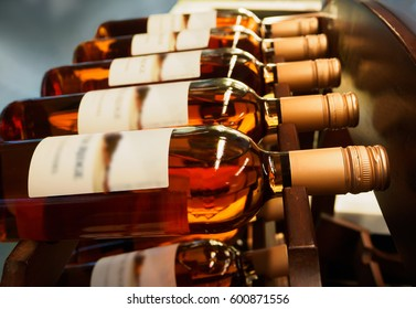 Bottles of wine or champagne on a wooden shelf