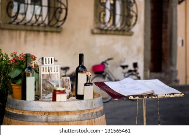 Bottles of wine on a barrel against a Italian restaurant background, August 2012