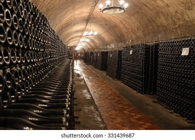 Bottles with wine are stored in the cellar