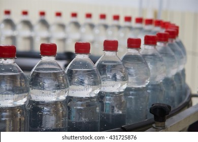 Bottling of mineral water in plastic bottles