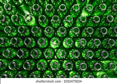 Bottling plant - Green glass bottles from above. Abstract background.
