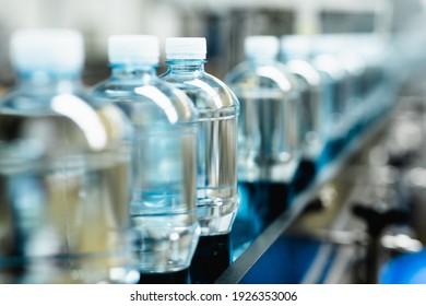 Bottling plant - Water bottling line for processing and bottling carbonated water into bottles. Selective focus.