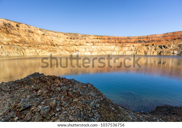At the bottom of abandoned mining crater with water near Tsar Asen village in Bulgaria