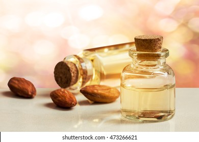 bottom of almond essence oil on stone floor.