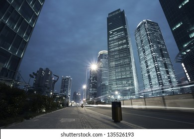 Bottom angle shooting highway car light trails of modern urban buildings