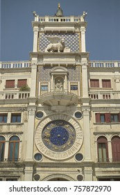 From the bottom of the clock tower in Piazza San Marco in Venice, with its distinctive clock visible.