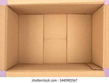 bottom of open empty brown cardboard box, top view