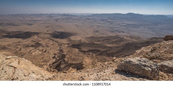 The bottom of Ramon Crater (Makhtesh Ramon), the largest in the world, as seen from the high northern rim, Ramon Nature reserve, Mitzpe Ramon, Negev desert, Beersheba, Israel