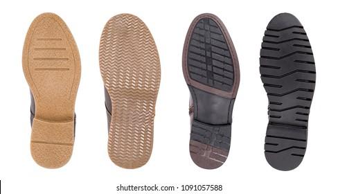 Bottom of shoes, isolated on white background. Elegant men shoe soles