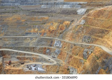 Bottom of surface mining and machinery in an open pit mine in Waihi, New Zealand
