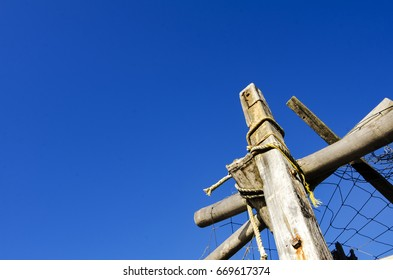 bottom to top view of wooden hut at sunny day over blue sky background