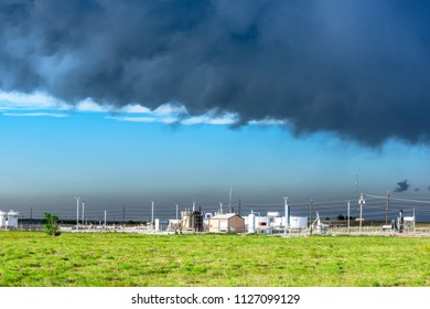 The bottom of a tornadic supercell moves over a small utilities business in a rural field in Roswell New Mexico.