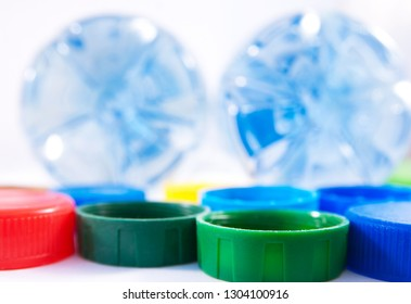 Bottom of two bottles of water and colorful covers. Close up image