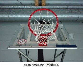 Bottom View from Basketball field, through the basketball hoop to the ceiling of the sports hall