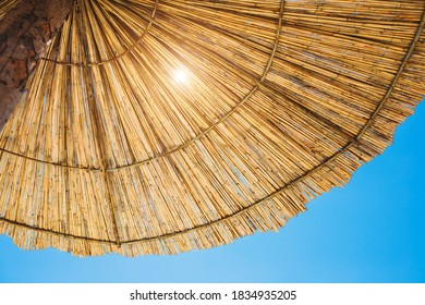Bottom view of a beach umbrella - shade from the bright sultry sun - preventing sunburn
