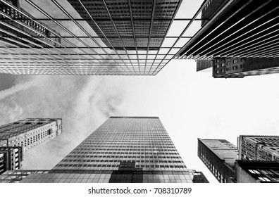Bottom view of business buildings skyscrapers in New York, black and white, vintage effect added