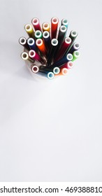 Bottom view of colorful magic pen on white background isolated.