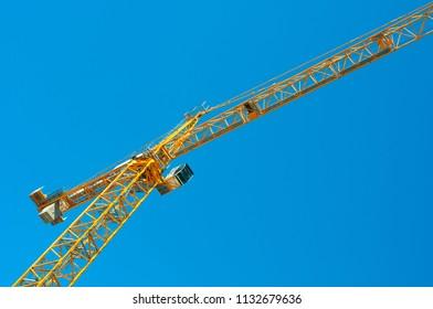 Bottom up view at construction crane
