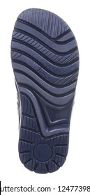 Bottom view of dark blue sole with Thomas heel of dark blue and gray leather and suede boy sandal with slits and slots and velcro, isolated on white