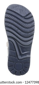Bottom view of dark blue sole with Thomas heel of black and beige leather and suede boy sandal with slits and slots, velcro and two clasps, isolated on white