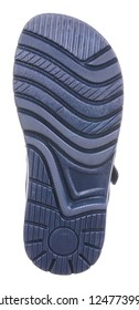 Bottom view of dark blue sole with Thomas heel of black, gray, blue and white leather and suede boy sandal with slits and slots and two velcros, isolated on white
