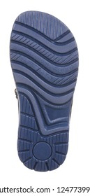 Bottom view of dark blue sole with Thomas heel of black, gray, blue and white suede boy sandal with slits and slots and two velcros, isolated on white