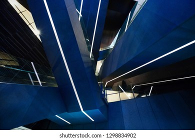 Bottom view of escalators at the modern shopping mall, Tokyo, Japan. Abstract pattern.