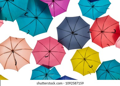 Bottom view of many umbrella of many colors on white background.