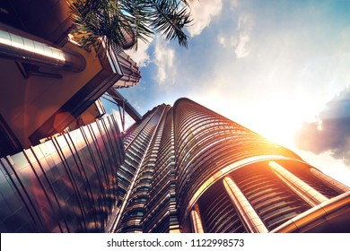 Bottom view of a modern skyscraper on a sunny day