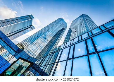Bottom view of modern skyscrapers in business district against blue sky - Shutterstock ID 263024672
