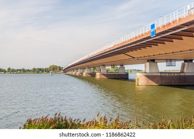 Bottom view of the Moerdijk traffic bridge over the Hollandsch Diep river and part of the A16 motorway. The bridge was built in 1978 and it is the longest river bridge in the Netherlands (1040 meter).