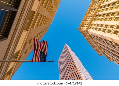 Bottom view of office skyscrapers and the flag of USA on the background of clear sky, Atlanta