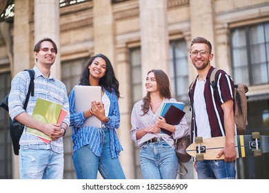 Bottom view on exchange students with bags happily start their school day.