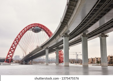 bottom view of the road bridge with a red arch, the picturesque bridge across the Moscow River, the picturesque bridge with a flying saucer
