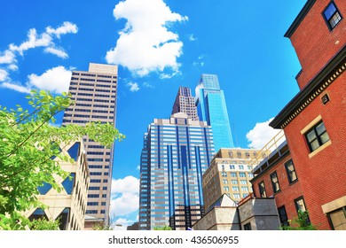 Bottom up view to skyscrapers mirrored in glass in Philadelphia, Pennsylvania, USA. It is central business district in Philadelphia