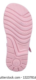 Bottom view of sole with Thomas heel of pink and white suede girl sandal with two velcros, isolated on white
