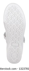 Bottom view of sole of white leather girl low shoe with bow-knot and velcro, isolated on white