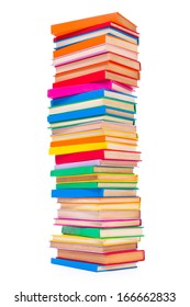 Bottom view of stacked colorful books on white background