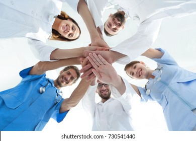 bottom view.a team of doctors at the medical center clasped their hands together