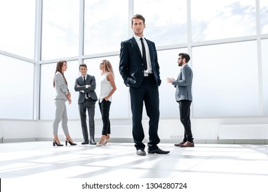 bottom view.confident businessman standing in a spacious hall