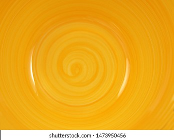 bottom of a yellow deep plate with a swirl pattern