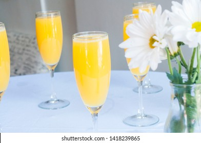 Bottomless Mimosas at Brunch Restaurant with Flower Accent