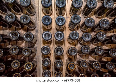 Bottoms of wine bottles stacked in cellar