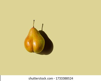 bottom-shaped pear on olive background. physical shape concept. copy space horizontal, top view