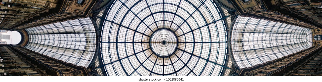Bottom-up panorama of the Galleria Vittorio Emanuele II arcade with the glass dome in the center. The Galleria is the oldest active shopping mall and located in Milan, Italy.