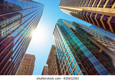 Bottom-up view of skyscrapers mirrored in glass in Philadelphia, Pennsylvania, USA. It is central business district in Philadelphia