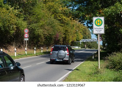 BOTTROP, GERMANY - AUGUST 29, 2018: School bus stop along a busy road
