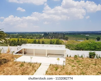 BOU ARGOUB, TUNISIA - JUNE 22, 2018: A white pavilion with roof terrace in the garden of Château Bou Argoub which is known for the production of fine red wines, Tunisia, North Africa